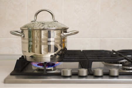 37835531 - boiling pot on the gas stove fire